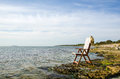 Chair by the coast armchair flat rock of baltic sea on island oland in sweden Royalty Free Stock Photography