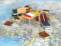 Chair and desk with books on the world map.