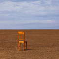 The chair on the field lonely a cultivated Stock Image