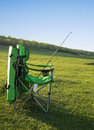 Chair fisherman and a fishing rod. Royalty Free Stock Image