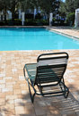 Chair in front of a swimming pool Royalty Free Stock Photography