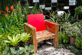 Chair and garden Stock Photography