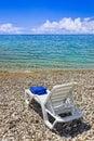 Chair at greek beach Royalty Free Stock Photo