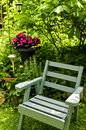 Chair in green garden Stock Photography