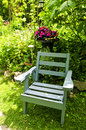 Chair in green garden Stock Images