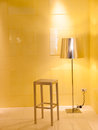 Chair and lamp interior design scene with a white Stock Photography