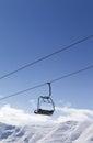 Chair lift against blue sky Stock Photos