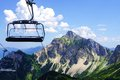 Chair lift in the alps Royalty Free Stock Photography