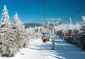 Chair lift mountain downhill skiers Stock Photo