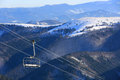 Chair lift on mountains background