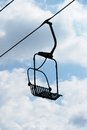 Chair lift winter ski chairs on bright day Royalty Free Stock Photo
