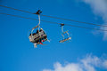 Chair lifts with sky and clouds Stock Photo