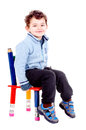 Chair little boy isolated in white Stock Photography