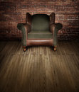 Chair on stage a leather and fabric backlit a wooden with red brick backdrop concept for interview Royalty Free Stock Image