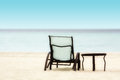 Chair and Table on the Beach Stock Photography
