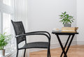 Chair and table with books to read room black decorated plants Stock Photos