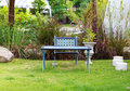 Chair and table in garden a Stock Image
