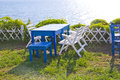 Chair and table in garden wooden on lawn for outdoor restaurant at the seashore Stock Photo