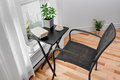 Chair and table in a room with green plants black bright Royalty Free Stock Photos