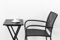 Chair table and teacup black white cup of tea or coffee Royalty Free Stock Images