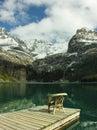 Chair on a wooden pier lake o hara yoho national park canada british columbia Royalty Free Stock Photos