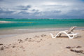 Chairon the beach ile aux cerfs mauritius chair on tropical sand with blue ocean Royalty Free Stock Photography