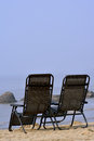 Chairs at beach Stock Photography