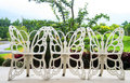 Chairs in the butterfly garden. Royalty Free Stock Photography