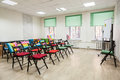 Chairs with colored capes in hall for seminar or meeting Royalty Free Stock Photo