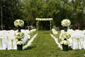 Chairs flowers outdoor wedding Royalty Free Stock Images