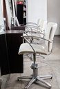 Chairs in hair salon row of Royalty Free Stock Images