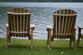 Chairs by the lake two sitting beside a beautiful Stock Photo