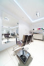 Chairs and mirrors in hairdressing Royalty Free Stock Photo