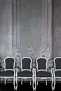 Chairs near wall comfortable against luxury white design with mouldings Royalty Free Stock Photos