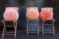 Chairs with pink pompoms Royalty Free Stock Photo