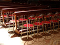 Chairs row of church italy Royalty Free Stock Image