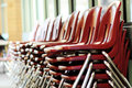 Chairs row of stacked up red Royalty Free Stock Photos