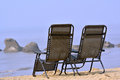 Chairs seaside on sand Royalty Free Stock Photos