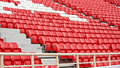 Chairs in the stadium new red and white Royalty Free Stock Image