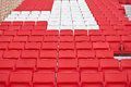 Chairs in the stadium new red and white Royalty Free Stock Photos