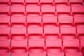 Chairs in the stadium new red and white Stock Images