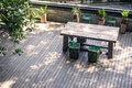 Chairs and a table in small wood platform Royalty Free Stock Photos