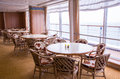 Chairs and tables ina restaurant on the cruise deck by the window Stock Photography
