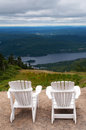 Chairs on top of mountain at a ski resort two during summer time depicting relaxing concept Royalty Free Stock Photo