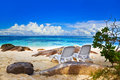 Chairs on tropical beach at seychelles vacation background Royalty Free Stock Photos