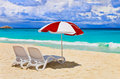 Chairs and umbrella at tropical beach Stock Photography