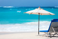 Chairs and umbrella on tropical beach a beautiful at anguilla caribbean Royalty Free Stock Photo