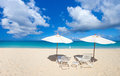 Chairs and umbrella on tropical beach a beautiful at anguilla caribbean Stock Photo