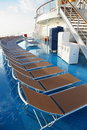 Chaise longues on deck of cruise ship Stock Photo