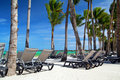 Chaise longues on tropical beach Stock Photos